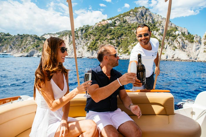 Sea Capri boat and prosecco serving the best italian travel planning european holidays
